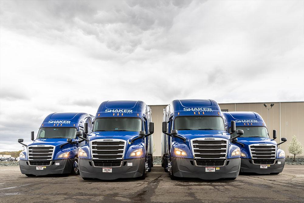 Fleet of blue tractor trailers