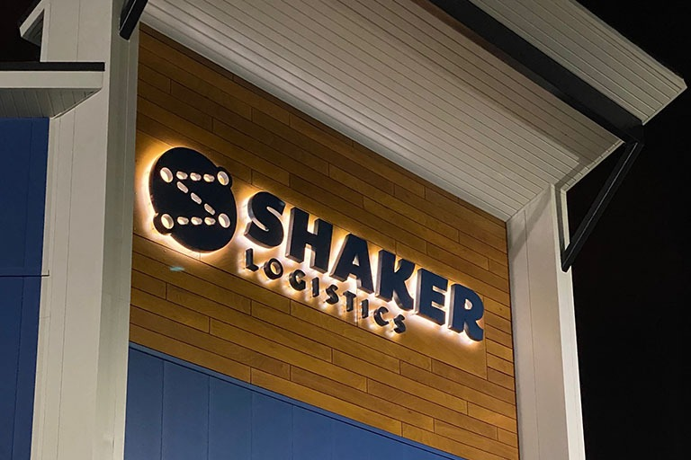 Shaker Logistics headquarters building at night